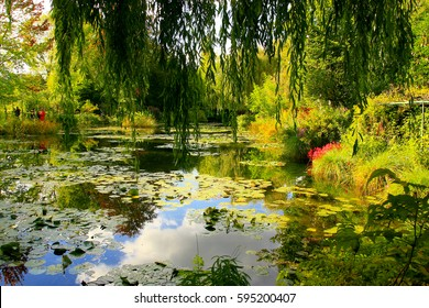 Reflections of clouds and sky in the water lily pond of Claude Monet's garden of Giverny, France