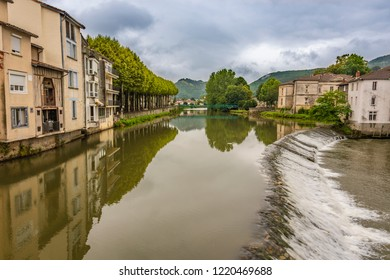 Reflections and dam on the Salat River in the old village of Saint Girons. Ariege France