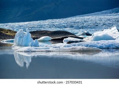 Reflections in Fjallsarlon lagoon, Iceland in June