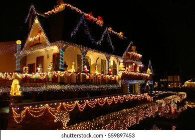 Reflections of house with Christmas lights in Venice California