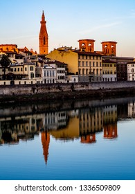 Reflections of the houses on the river Arno in Florence