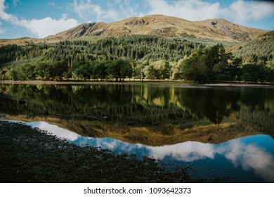 Reflections in Loch Lubnaig lake, Scottish Highlands