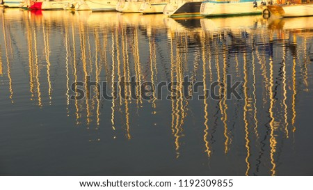 Reflections of masts at dusk
