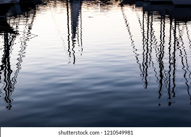 reflections of the masts of sailboats at the port of Palermo, Sicily
