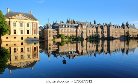 Reflections of the Mauritshuis and the Binnenhof (13 century gothic castle) on the Hofvijver lake, The Hague, Netherlands