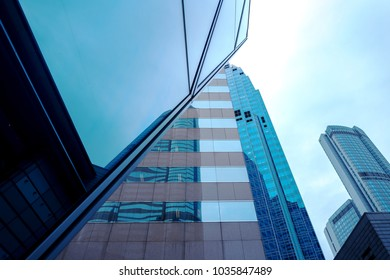 Reflections of modern commercial buildings on glasses