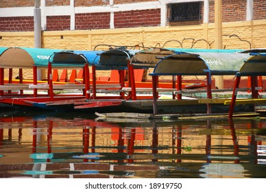 Reflections of moored colored boats,		Xochimilco canals, floating gardens, 	Mexico City