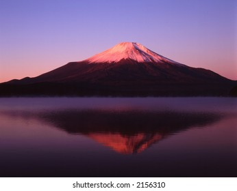 Reflections of Mount Fuji in a still early morning lake