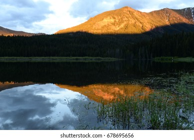 Reflections of a Mountain in a Lake