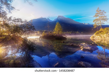 Reflections at the mountain lake in the alps