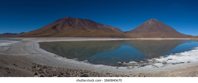 Reflections of mountains in the clear water of the Green Lake (Laguna Verde) on the Bolivian altiplano, Bolivia