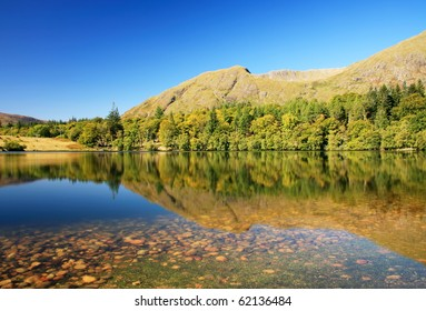 Reflections on a Highland Lochan at Ardgour.