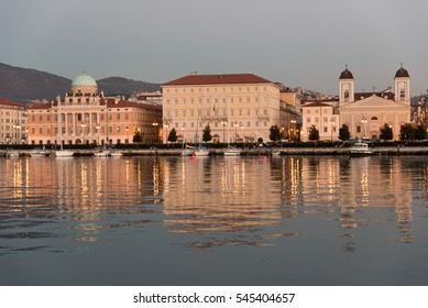 Reflections on the sea of Trieste at dusk - Historical buildings and lights
