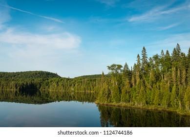 Reflections on a small lake north of Lake Superior