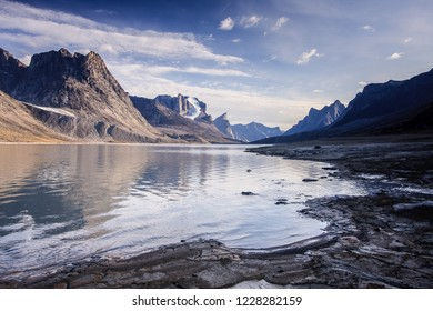 Reflections on Summit Lake in Akshayuk Pass, Nunavut