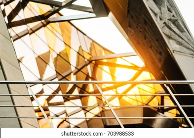 Reflections and optical effects of space distortion on the glass facade of a modern building. Abstract Architecture Blur Background