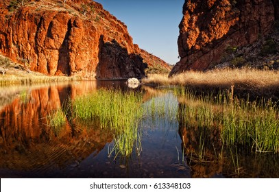 Reflections of rock formations at Glen Helen Gorge water hole in Northern Territory Central Australia