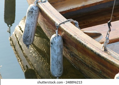 Reflections of row boat in calm water