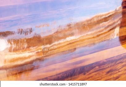 Reflections of the sea on a boat shell varnish mahogany color