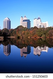Reflections of skyscrapers in Piedmont Lake, Piedmont Park, Atlanta, Gerogia, USA.
