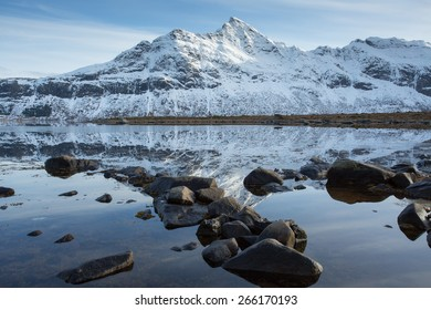 Reflections of snowy mountains at Selfjord, Lofoten, Norway