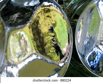 Reflections in steel drums. Photo taken in Baysville, Ontario, Canada.