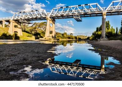 Reflections from a still Murrumbidgee river.
