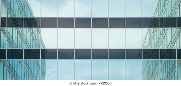 Reflections of surrounding buildings in a glass front
