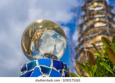 Reflections of a temple under construction in a crystal ball, at Phetchabun, Thailand.