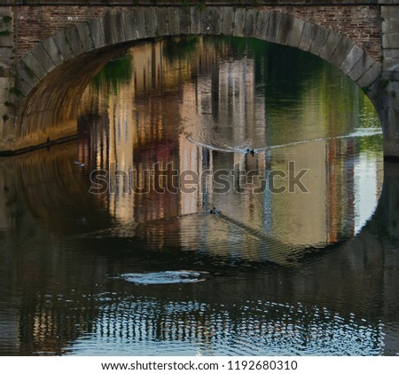 Reflections under a bridge in Castres, Southern France