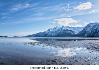 Reflections in the water at low tide in the Chilkat Inlet near Haines Alaska
