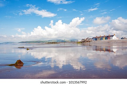 Reflections in the water on Borth beach, Wales, Cardigan bay in the summertime.