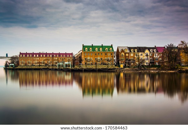 Reflections of waterfront buildings along the Potomac River in Alexandria, Virginia.