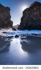 Reflections in wet sand on Pfeiffer Beach in California.
