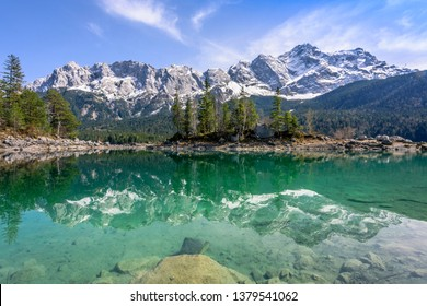 Reflections of Zugspitze mountain in turquoise Eibsee lake, Garmisch-Partenkirchen, Bavaria, Germany