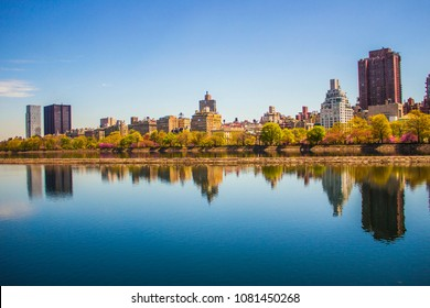 Reflective image of the New York City skyline, seen from across the Jackie Kennedy reservoir in Central Park.