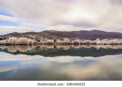 A reflective image of the surrounding mountains, taken at Lake Ruataniwha, South Island, New Zealand.