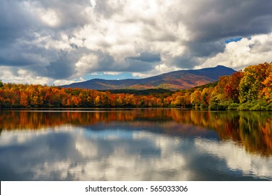 Reflective Price Lake in the Fall Blue Ridge Mountains, Appalachian Mountains, North Carolina