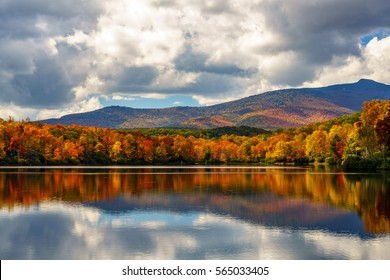 Reflective Price Lake in the Fall Blue Ridge Mountains, Appalachian Mountains, North Carolina