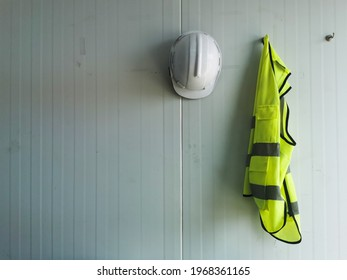 Reflective Vest and white Safety Helmet is Hang on the wall, can input text in left space,