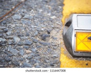 Reflectors on the street / Close up half Reflector Solar Road Stud on asphalt.