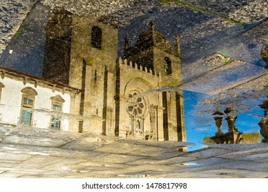 Reflexion of the catholic church in puddle in Porto, Portugal