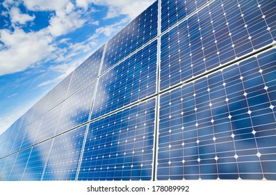 Reflexion of the cloudy sky on the photovoltaic modules