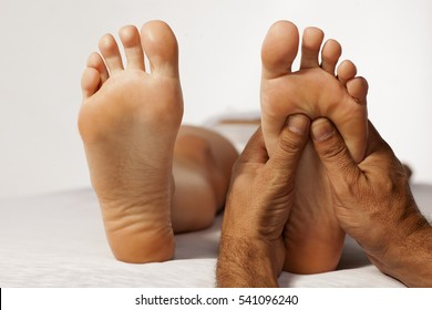 reflexology and acupressure on women's feet