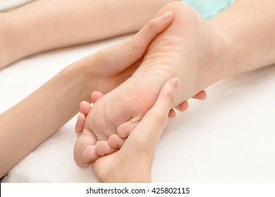 Reflexology foot massage in the day spa