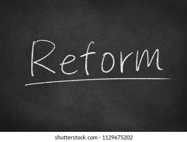reform concept word on a blackboard background