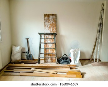 Reforms of interior in room with white wall and elements of construction