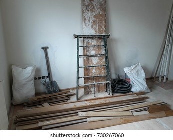 Reforms of interior in room with white wall and elements of construction.