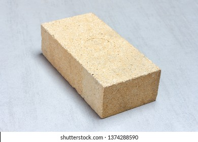 refractory brick for masonry fireplaces and stoves on grey background close-up