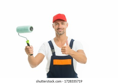 Refresh walls by yourself easily. Decorator hold paint roller. Wall painter. Paint work. Paint shop. Renovation and repair. Renewal and redecorating. Professional equipment. Mature man in cap.